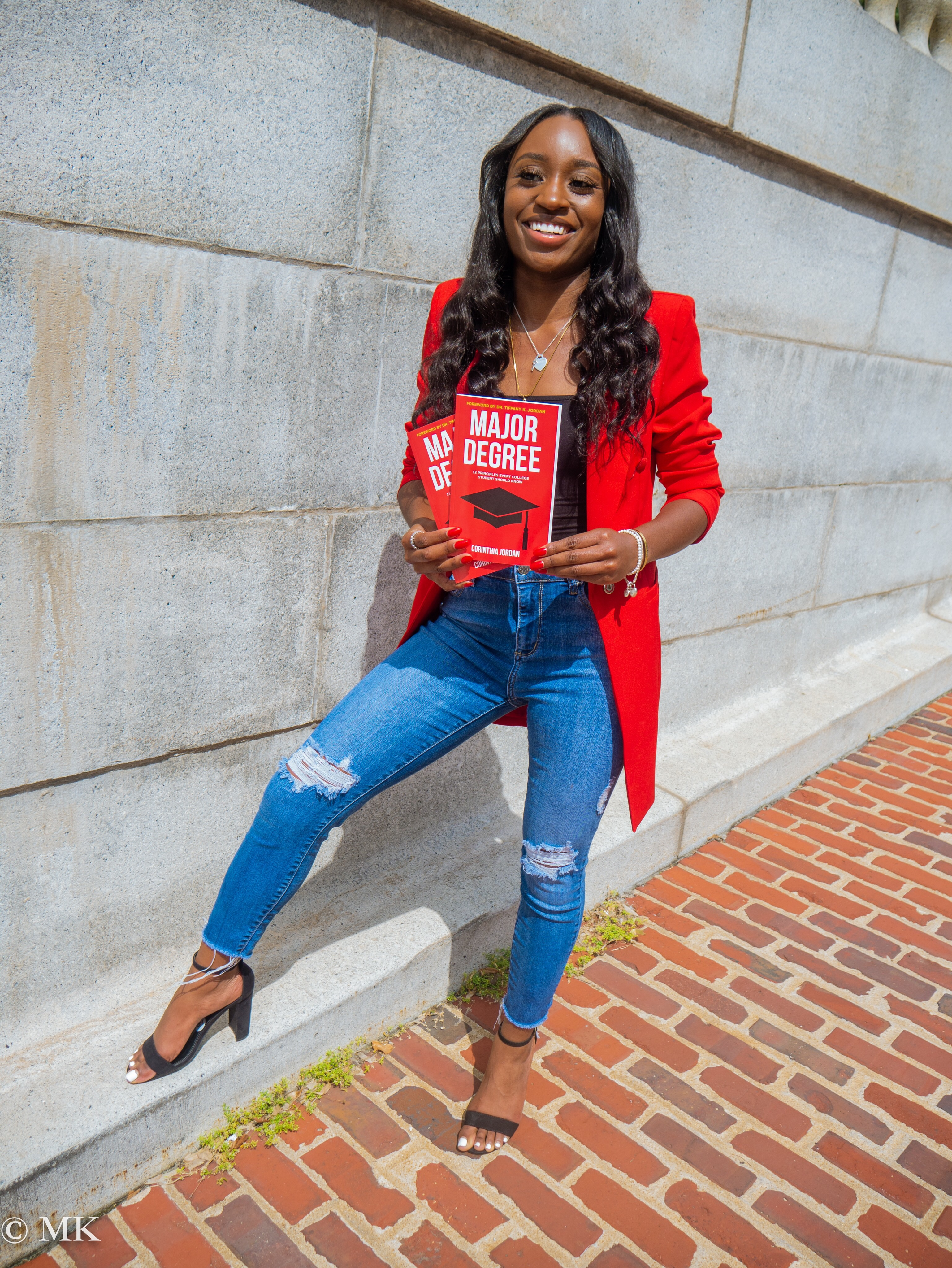 "23-year-old college graduate and author releases another bestseller titled ""Major Degree"""