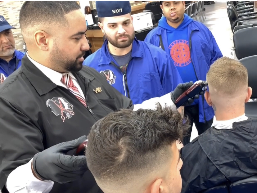 This Barber Can Do Two Haircuts At The Same Time, Ambidextrously